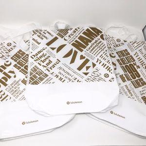 Lululemon Gold/White LTD Edition Shopping Bags
